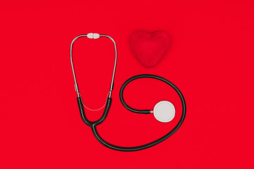 top view of stethoscope and red heart isolated on red tabletop, world health day concept