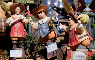 Figures representing Russian President Vladimir Putin, U.S. President Donald Trump, and North Korean leader Kim Jong Un are depicted at a monument at the start of the Fallas festival in Valencia