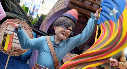 A figure representing former Catalan leader Carles Puigdemont is depicted at a monument during the Fallas festival in Valencia