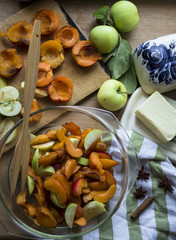 photo of sliced apples and apricots on the kitchen table