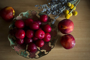 fresh, red fruits in a vintage plate