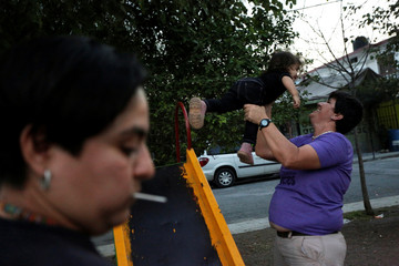 LGBT activist Jennifer Aguayo plays with one of her children at a park in Monterrey