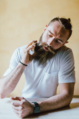 young bearded man sitting looking sideway