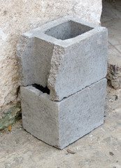 Two gray cement bricks