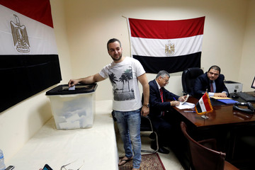 An Egyptian living in Sudan casts his vote at the Egypt Embassy in Khartoum