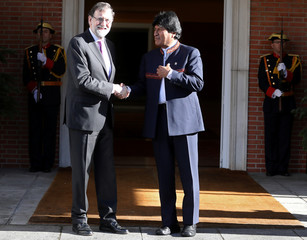 Spain's PM Rajoy greets Bolivia's President Morales at the Moncloa Palace in Madrid
