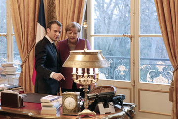 French President Emmanuel Macron and German Chancellor Angela Merkel meet at the Eylsee presidential Palace in Paris