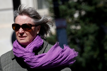 A woman walks along a windy block in Washington