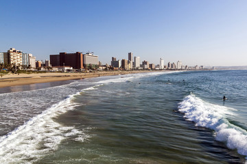 Coastal Shoreline against Blue Durban City Skyline