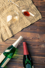Image of two wine bottles and wine glasses on napkin
