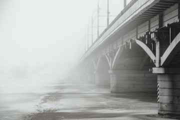 Winter fog in Voronezh. Chernavsky bridge fading in fog
