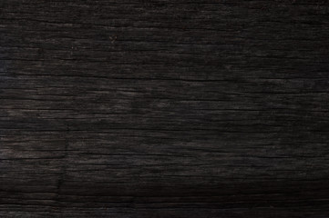 background of an old blackened wooden board