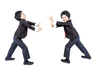 A young businessman pushes an imaginary wall. Isolated. White background.