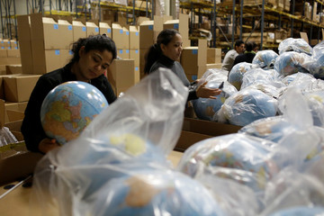 Toys 'R' Us vendor Learning Resources workers assemble globes at the warehouse in Vernon Hills