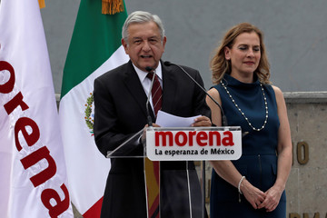 Leftist front-runner Andres Manuel Lopez Obrador, accompanied by his wife Beatriz Gutierrez Mueller, addresses his supporters after being registered as a presidential candidate in Mexico City