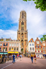 Traditional old buildings and tower of the Dom cathedral in Utrecht, Netherlands.