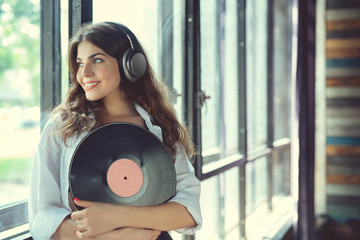 Young woman listen to music on headphones