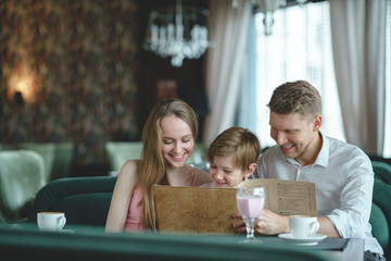 Smiling family in a restaurant