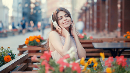 Smiling young girl listen to music on headphones