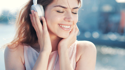 Young smiling girl listen to music