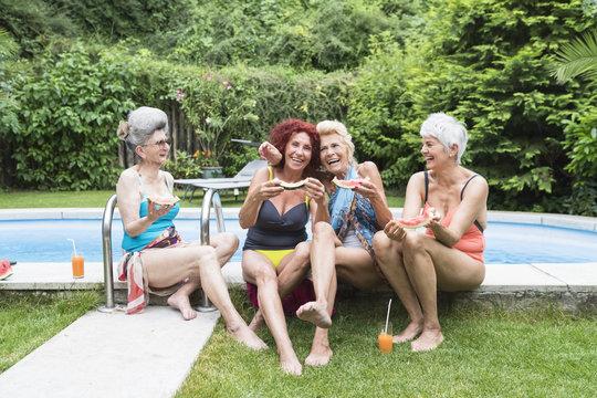 Happy women at swimming pool
