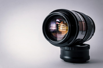 Close-up shot of photo lens on a white background.camera accessories, photographer concept design