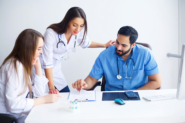 Group Of Happy Multiracial Doctors Working Together In Clinic
