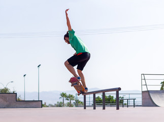 Young balancing on a skateboard in skate park