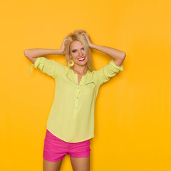 Beautiful Blond Woman Is Holding Head In Hands And Smiling