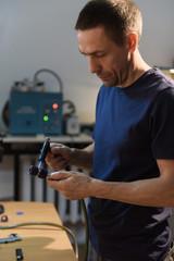 Man heating pipe in workshop