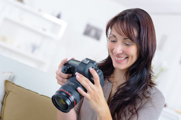 Woman reviewing photos on digital camera screen