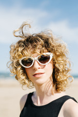 Woman in sunglasses on shore