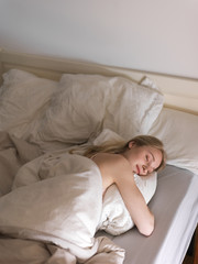 Attractive woman sleeping in morning
