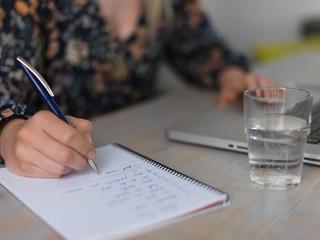 Woman at laptop writing plan