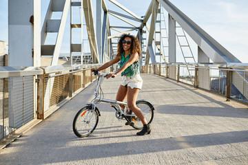 Happy girl on bike.
