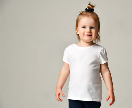 Toddler child baby girl kid standing in white free text space t-shirt