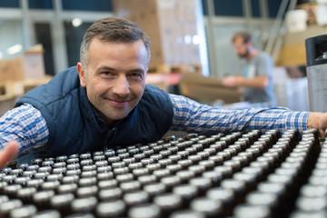 man in bottling plant