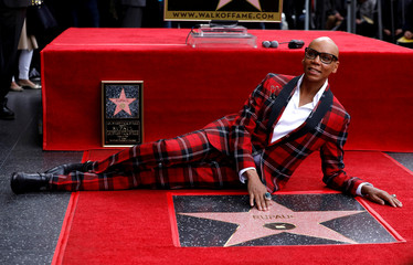 Television personality and drag queen RuPaul touches his star after it was unveiled on the Hollywood Walk of Fame in Los Angeles