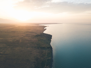 aerial shot of kazakh coastline from alakol lake