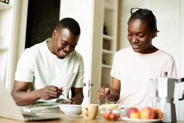African American family having breakfast