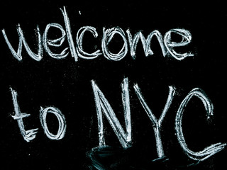 welcome to nyc text on blackboard isolated