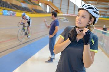 woman biker putting a helmet