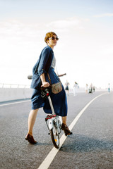 Stylish model on bicycle