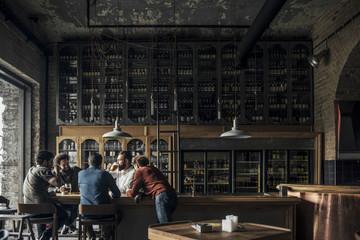 Men Drinking Beer at Bar