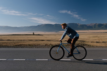 Man riding bicycle on landscape
