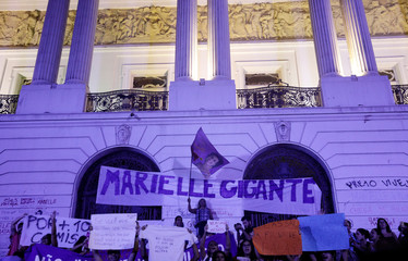 Demonstrators take part in a rally against the shooting of Rio de Janeiro city councilor Marielle Franco in Rio de Janeiro in front of the city council chamber, Brazil