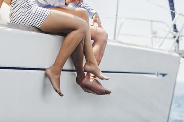 Couple Enjoying Summertime on Sailing Boat