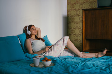 Woman Listening  to the Music in Bedroom