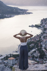 Woman standing on the Kotor fortress looking over the Kotor bay