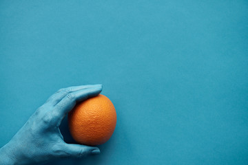 Ripe Orange Against Turquoise Background